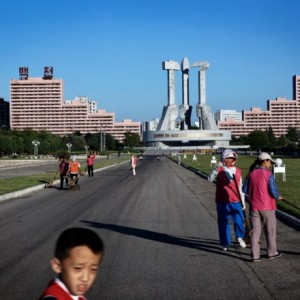 Street cleaners in front of the Party Monument, Pyongyang