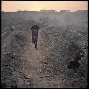 "06/02/2012. A ""illegal coal miner"" returns home after a hard day's work in an apocalyptic territory on the outskirts of the town of Jharia."