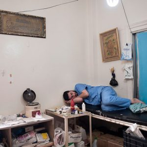 Al Qusayr, Syria - 2012. A nurse is resting after a day's work.