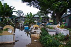 CAMBODIA - September 2011. Gravestones stick out of the water during the 2011 monsoon in Doeum Sleng village.