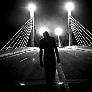 Iñapari, January 2012, A haitian refugee walks along the bridge that separates Iñapari (Peru) with Assis, in Brazil. This bride was close to them for almost 4 months.