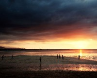 East Timor, August 2012. Sun set and low tide. Areia Branca beach, Dili.