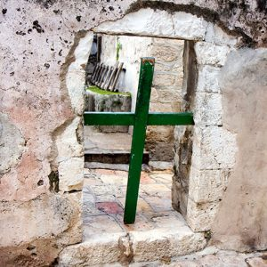 Jerusalem, Israel - January 2012. A cross on the roof of the Church of the Holy Sepulcher, preventing entrance to the Ethiopian Orthodox privet part.