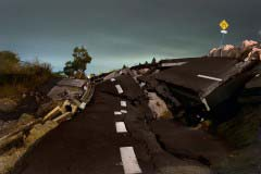 """<br />A devastated road close to the J village, in Iwaki area. Iwaki, considered by many to be a """"nuclear town,"""" is the closest large city to the Fukushima Daiichi nuclear reactor. The bulk of the nuclear facility's workers lived in Iwaki, it is very common to hear from locals the positives of nuclear energy here, unlike the rest of the country."""