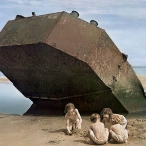 © Chim. Children playing on Omaha beach, Normandy, France, 1947