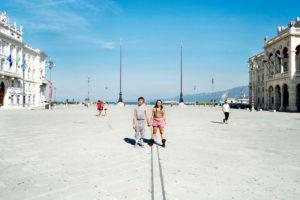 Trieste, Italy August 2012 - A portrait of Donatella and Gabriele in Piazza Unità, the symbol of Trieste.