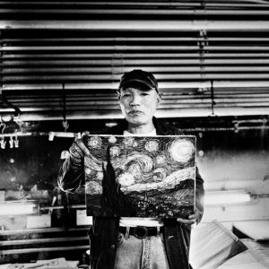 Tokyo, Japan - May 2012. Portrait of Toshihito with his reproduction of the 'starry night'.