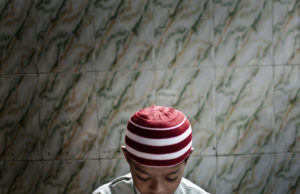 Barrackpur, India - August, 2013. A little boy is waiting for friday prayer at a local mosque.