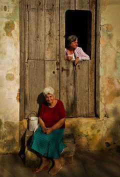 San Antonio de los Baños, Cuba - march 2013. Residents talking in the door in a ordinary evening of winter