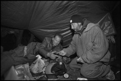 OAKLAND, CA - 11FEBRUARY14 -Pannizzo gives food and a couple of dollars to John, a homeless man in his camp beside the freeway.