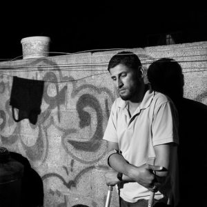 Emad Owda, 30 yrs old, is seen in Gaza, Palestine in 2012. It was late at night on January 14th, 2009 when Emad decided to flee the area, as his family already had, due to a massive shelling. He was with a friend when he was hit by a drone. His friend died immediately while he was left bleeding for 40 minutes with severe wounds. Then an ambulance arrived and took him to the hospital where he stayed for 3 days, before being transferred to Egypt. He lost a leg, while the other one is severely damaged. He also lost his right eye. He is a father of 3 children. He said that after the war he went to the PCHR center in the north of Gaza, in the Jabalia camp, to describe what happened to him.