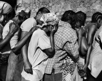 Port-au-Prince, January 2010. Earthquake survivors stand in line waiting for the food distribution, Riccardo Venturi