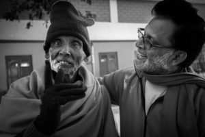 Joseph Dass with an 80 year old inmate. Kolkata, India, 2014