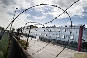 4 Stelle Hotel, Tor Sapienza, Rome, 2014. The Hotel is protected by barbed wire and barricades built by the tenants.