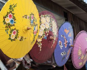 Bo Sang, Chiang Mai, Thailand. January 2015. Shops lined with hand crafted umbrellas.