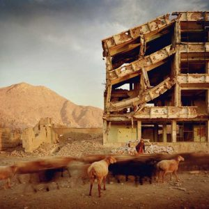Simon Norfolk Bullet-scarred apartment building and shops in the Karte Char district of Kabul. This area saw fighting between Hikmetyar and Rabbani and then between Rabbani and the Hazaras,  2003 © Simon Norfolk