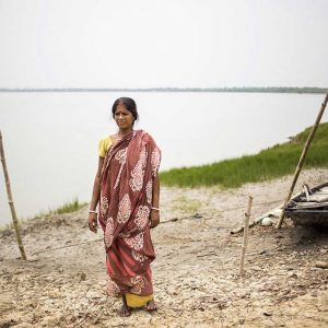 PAKHIRALA, SUNDARBAN, INDIA - April 2015. Shephali Mandal, 36, was attacked by crocodile on 2005 during shrimp fishing in the river. She doesn't go to river for fishing anymore after the incident.