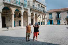 HAVANA, CUBA - May 2015. American tourists taking a photo with their iPad in Old Havana.