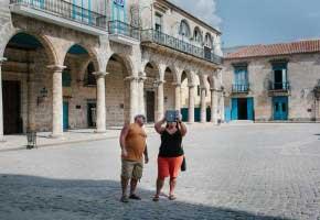 HAVANA, CUBA - May 2015. American tourists taking a photo with their iPad in Old Havana.