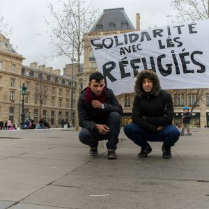 Paris, France - January 2016. *Ibrahim (22) and Shabab (22) confront the cold winter of Paris living in the Place de la Republic