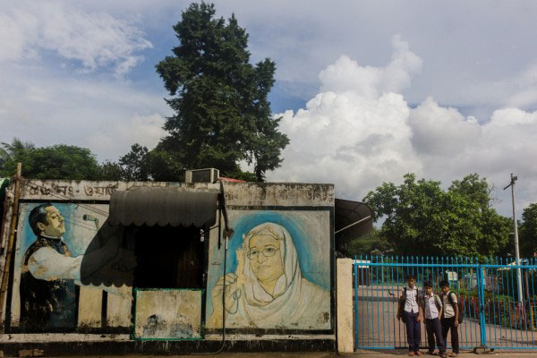 Dhaka,Bangladesh-August 2015.Some school kids were waiting outside of the main gate of the park to enter inside.