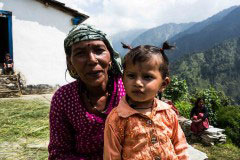 Uttarakhand, India - September 2015. A grandmother holds her grandaughter in a Himalayan village.