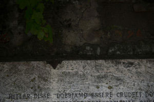 "Monte Sole (Marzabotto), Bologna, Italy, October 28, 2015. Adolf Hitler said"" We must be cruel we must be with quiet consciousness. We must destroy technically, scientifically"" those words are impressed on a stone of the entrance wall at the Casaglia cemetery. On the Marzabotto area, situated on the Appennini mountains between Bologna and Florence, the German Nazists special forces SS with the help of Italian fascists, accomplished one of the biggets slaughter against the local civil population of the Second World War, killing 1836 people, including 250 children. Only at the Casaglia cemetery were killed by machine guns and hand grenades 195 people between them 25 children."