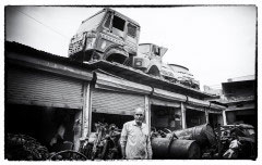 DELHI, INDIA - November 2015. Scrap vehicles deposited on the roofs of factories