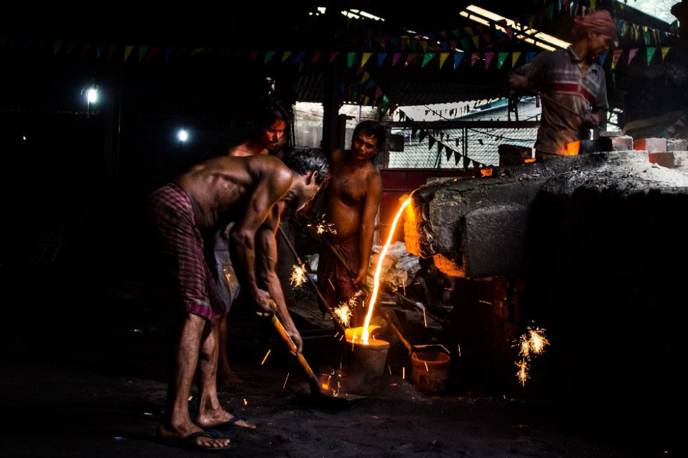 Kolkata,India-July 2015. Collecting the iron