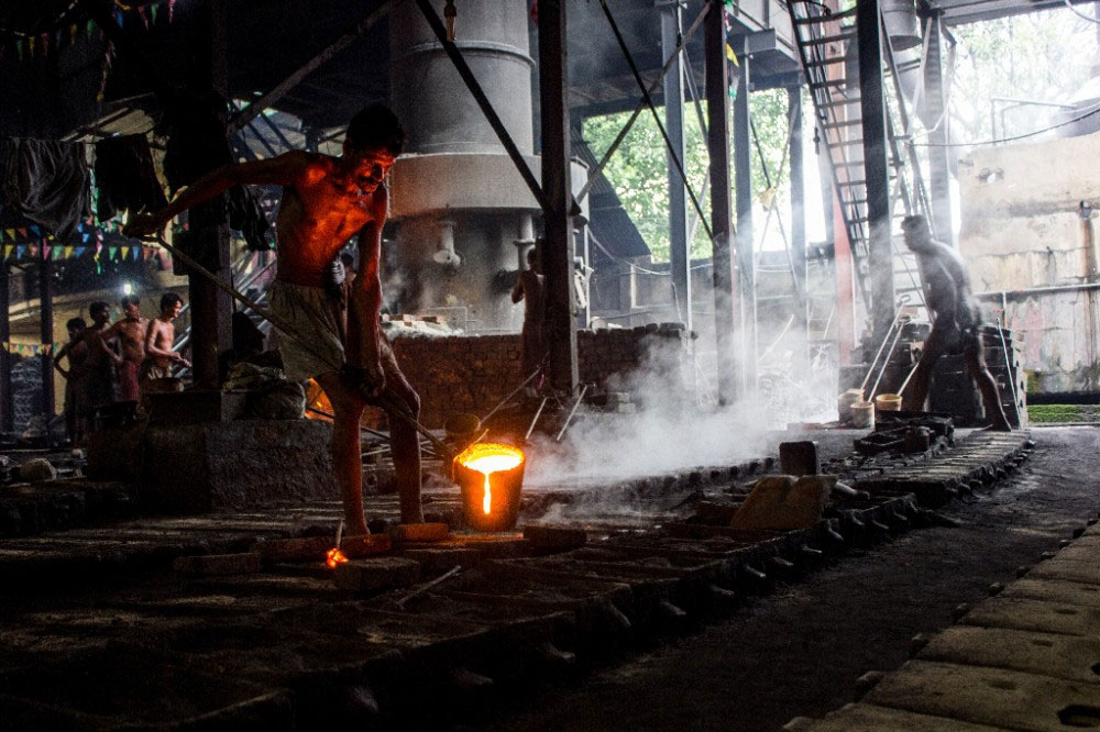 Kolkata,India-July 2015.Pouring hot iron in molds