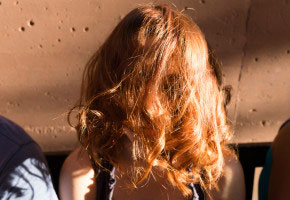 07/18/2015 - Rome (Italy). Chiara is 17 years old hiding her face behind her hair for a joke