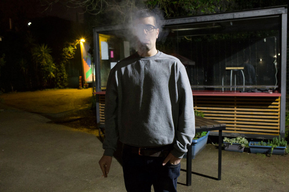01//05/2016 - Rome (Italy). Davide smoke in the garden of a club where a musical band which includes some guys of herapeutic rehabilitation center plays.