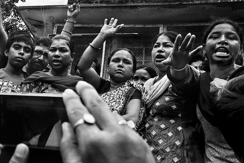 Birati, Kolkata, India - 19th August 2015. Women were lodging their greivances to the local media person.