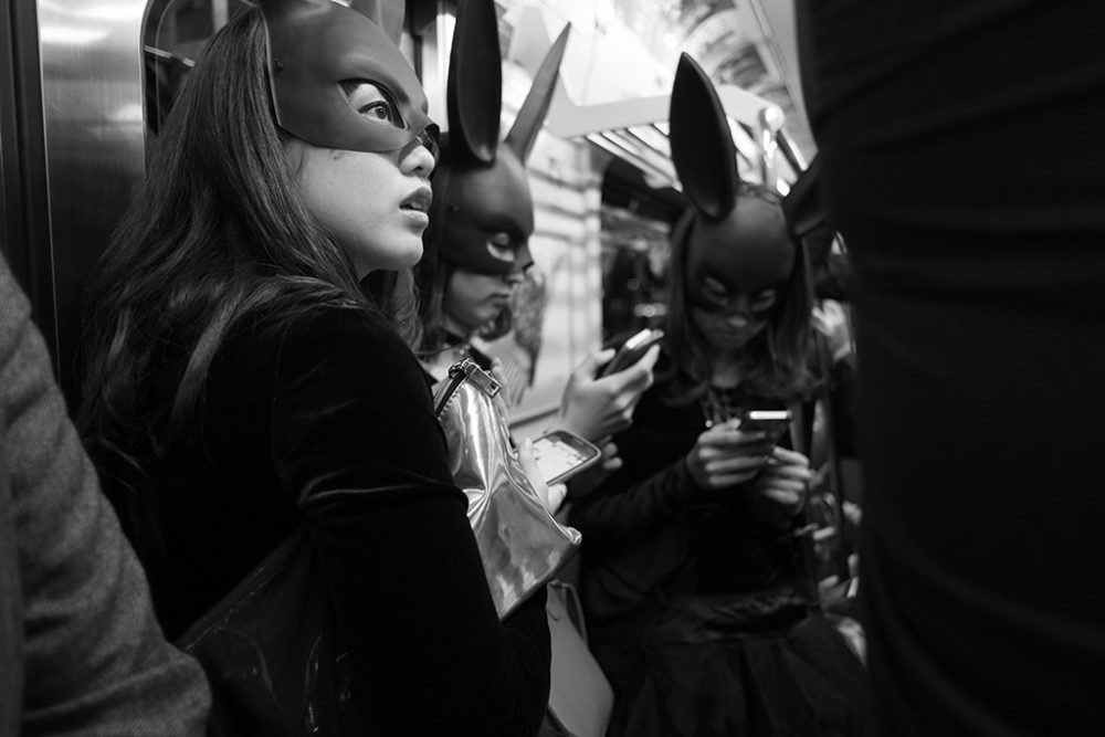 TOKYO, JAPAN - October 2015. Bat-women returning home after Halloween party.