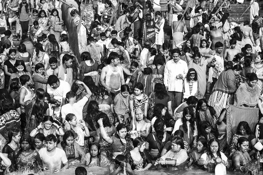 Howrah, India, February 2016, Thousands of men, women and children gather around the ghats to take the holy dip