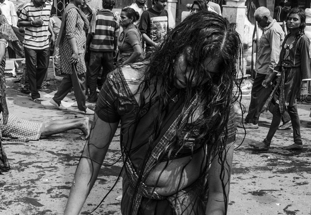Howrah, India, February 2016, A woman 'possessed by demons' on the streets towards the temples