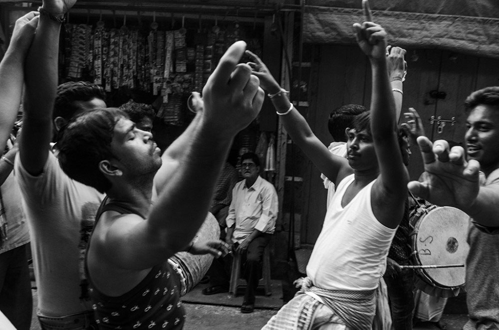 Howrah,India, February 2016, Men dance in the afternoon forgetting the struggle they went through the whole morning