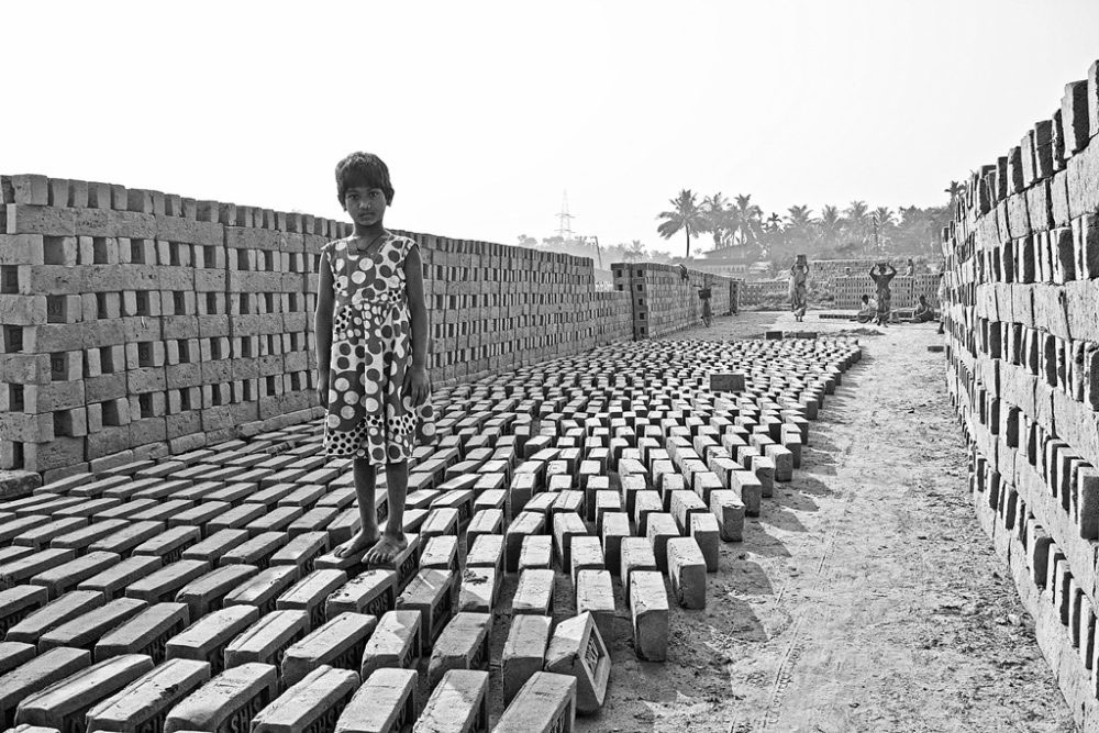 Kolkata, India- February 2016. Bricks being dried in the sun.