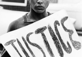 "Protester Carrying ""Justice"" Sign, Monroe, North Carolina, August 26, 1961."