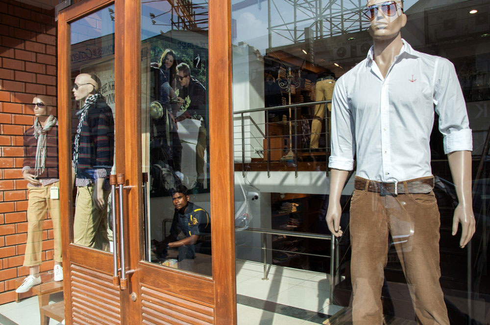 Bangalore, India - March 2013 - A migrated man from the village work as a securoty guard in a multinational shop
