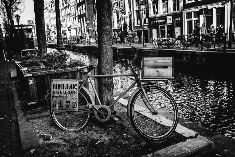AMSTERDAM, NETHERLANDS - February 2016 - The lanes along side the canals and whistling bicycles welcome you in Red Light District
