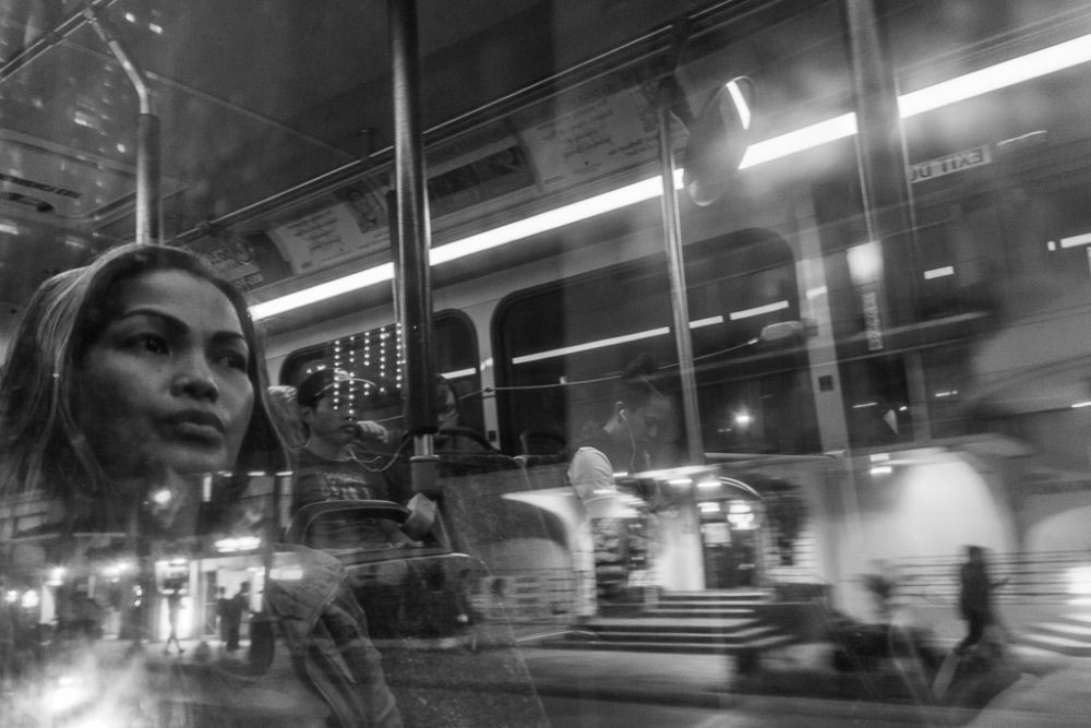 Honolulu, Hawaii - August, 2016. I see people being apathetic while riding the bus. They sometime engulfed themselves in any sort of deep facts or issues. So to me reflections are a great way to capture such moments without disturbing the subject.