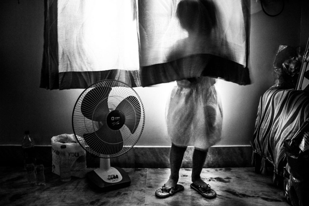 9. KOLKATA, INDIA - June 2016. Shreyasee's daughter. Her mother is the whole world for her, as long as she's deprived of the care of her father.