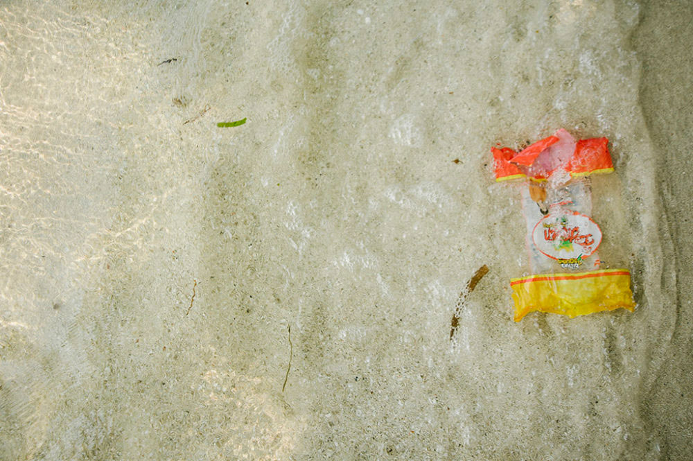 JAKARTA, INDONESIA - SEPTEMBER 03 : A plastic packaging as the ocean approaches to drift it out to sea, on Thousand Islands, Jakarta, in Indonesia, 03 September 2016.