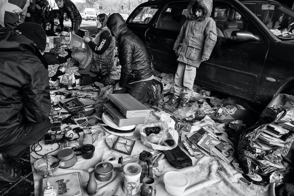 A boy looks over his parents wares