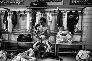 "Florence, Italy - June 2016; a player of the Bianchi (""Whites"") di Santo Spirito team is seen in a dressing room after the last training before a match of Calcio."