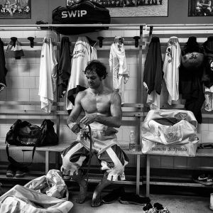 """Florence, Italy - June 2016; a player of the Bianchi (""""Whites"""") di Santo Spirito team is seen in a dressing room after the last training before a match of Calcio."""