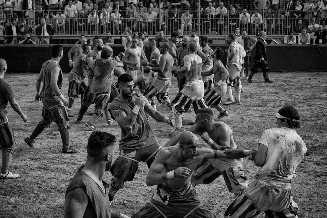 """Florence, Italy - June 2016; players fight for possession of the ball during a match of Calcio Fiorentino. King Henry III of France, son of the Florentine noblewoman Catherine de' Medici, in 1574 described Calcio as """"too small to be a real war and too cruel to be a game""""."""