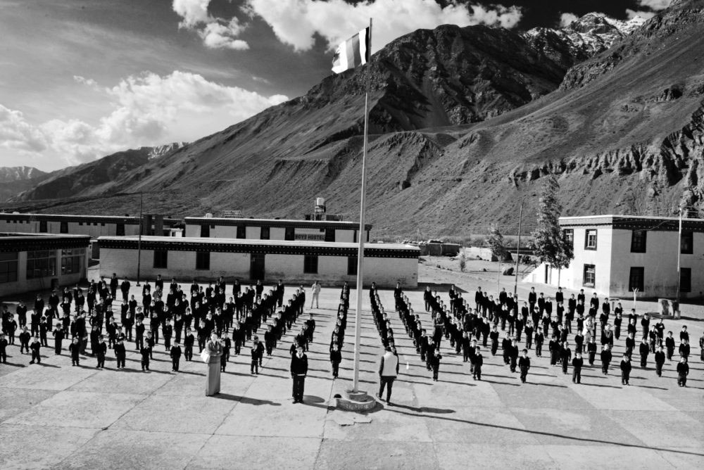 Tabo,Himachal Pradesh-June 2015.Prayer begins at the school compound surrounded by tall mountains.