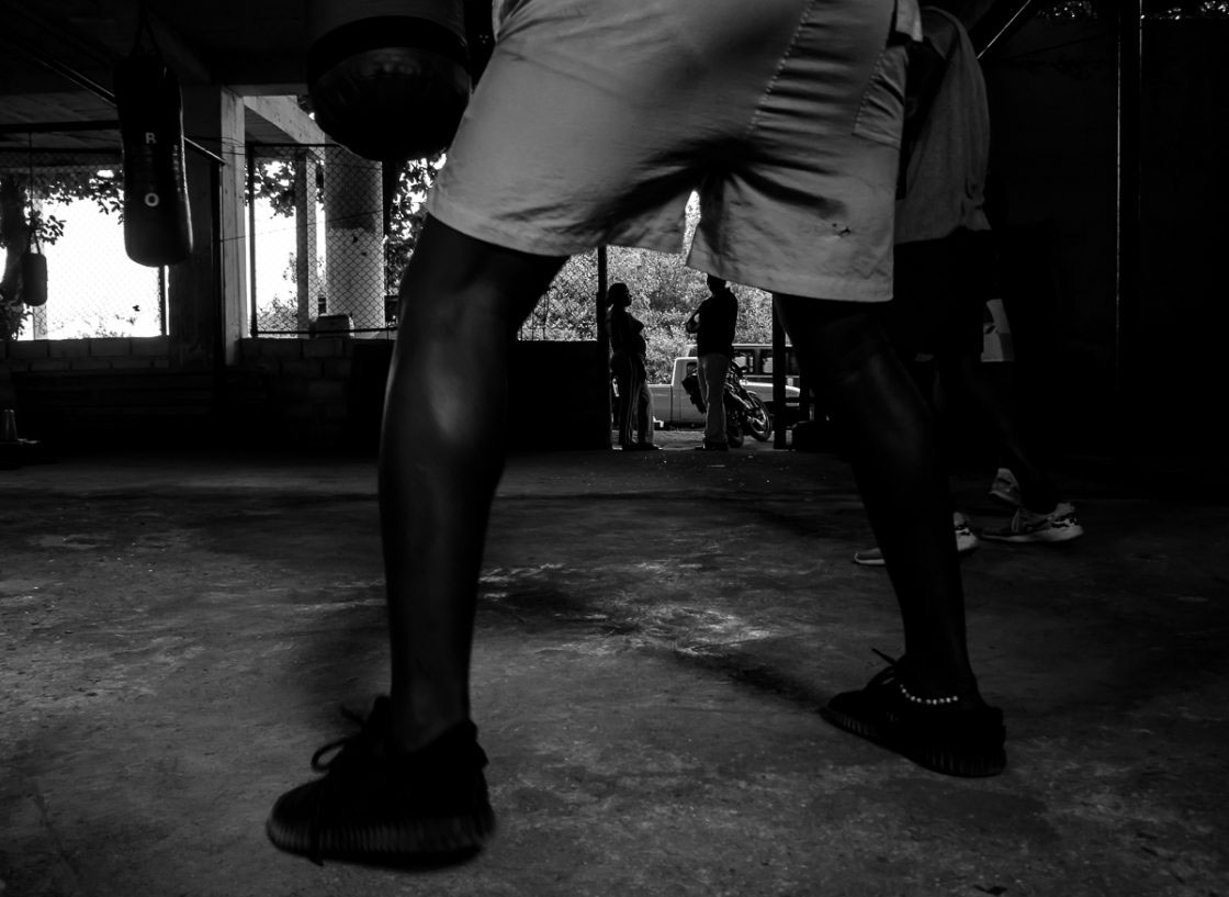 San Andrés, Colombia - October 2016. Friends of the gym often come and watch the students train, giving their opinion on techniques and talents.